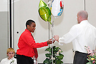 Quentin Gravers receives the honor roll award during the 8th grade recognition ceremony at Cleveland PK-8 School in Dayton, May 25, 2012.