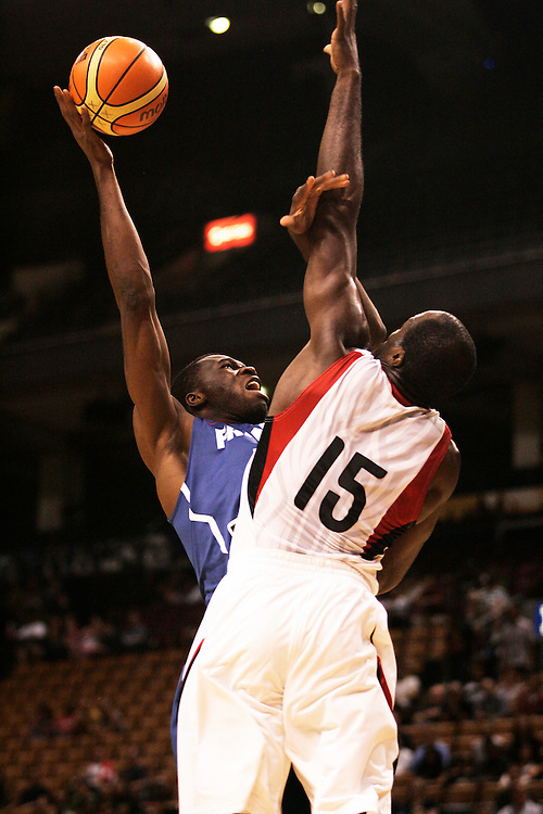 GJR512.jpg -20100813- Toronto, Ontario,Canada<br /> France's Alain Koffi tries to shoot over Canada's Joel Anthony during their team's second meeting in the 2010 Jack Donohue International Classic basketball tournament in Toronto, Canada August 13, 2010<br /> AFP PHOTO/Geoff Robins