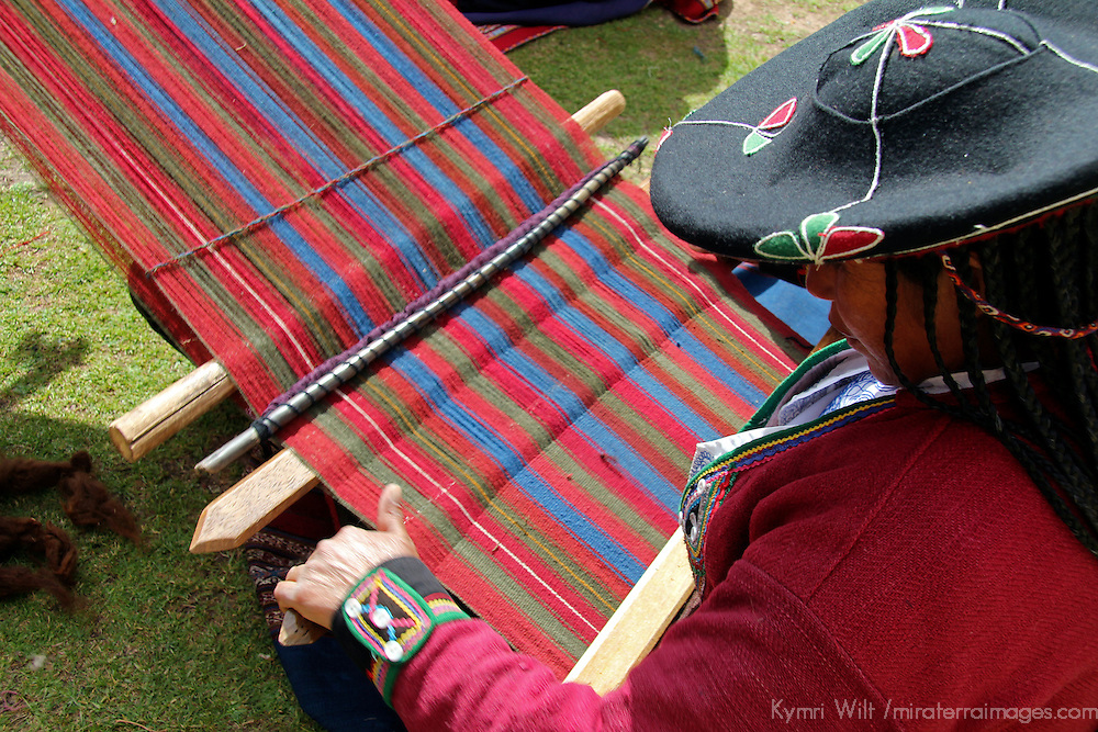 South America, Peru, Chinchero. Woman weaving at the Center for Traditional Textiles in Cusco Cooperative.