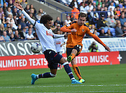 Jed Wallace unleashes a shot during the Sky Bet Championship match between Bolton Wanderers and Wolverhampton Wanderers at the Macron Stadium, Bolton, England on 12 September 2015. Photo by Mark Pollitt.