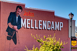 Seymour Indiana - A store named This Old Guitar has a partially completed image of John Mellencamp on its brick side facing the parking lot.<br /> <br /> HDR (High Dynamic Range) post processing applied.