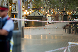 A cordoned off area after a van ploughed into the crowd, killing 13 persons and injuring over 80 on the Rambla in Barcelona, Spain on August 17, 2017. A driver deliberately rammed a van into a crowd on Barcelona's most popular street on August 17, 2017 killing at least 13 people before fleeing to a nearby bar. Officers in Spain's second-largest city said the ramming on Las Ramblas was a 'terrorist attack'.  (Photo by Hugo Fernández Alcaraz/NurPhoto/Sipa USA)