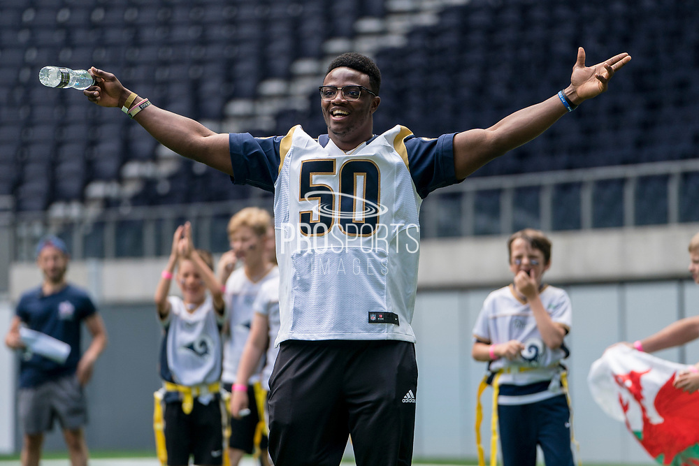 Samson Ebukam (LB, LA Rams) cheers as his team scores a touchdown during the NFL UK Media Day at Tottenham Hotspur Stadium, London, United Kingdom on 3 July 2019.