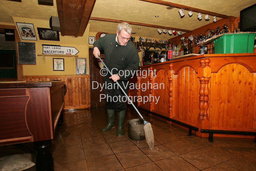 29/10/2004.Seamus Cagney pictured mopping up at the Bridge Bar on Old Bridge street in Clonmel yesterday..Picture Dylan Vaughan