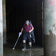 "Mudlarker Malcolm ""Mack"" Macduff uses a metal detector as he looks for items on the banks of the River Thames in London, Britain May 24, 2016. When the river Thames is at low tide, mudlarkers scour the shore for historical artefacts and remains from there City of London's ancient past. Finds can date back to Roman times to when the city was found up until more recent times. Anyone can walk along the river and look for finds, but the uses of metal detectors and digging is restricted. Mudlarkers need to be licences by the Port of London Authority. All find should be register with the Museum of London. REUTERS/Neil Hall"