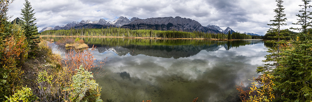 Spillway Lake reflects the Opal Range in Peter Lougheed Provincial Park, Kananaskis Country, Alberta, Canada. Kananaskis Country is a park system in the Canadian Rockies west of Calgary. This panorama was stitched from 12 overlapping photos.