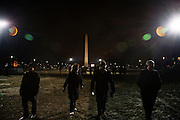 Obama Inauguration - Monday activities around the Capitol on Martin Luther King Jr. Day. Crowds wander around the National Mall at nightfall on the eve of Obama's inauguration. The Washington Monument.