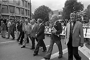 H-Block Protest To British Embassy.  (N86)..1981..18.07.1981..07.18.1981..18th July 1981..A protest march to demonstrate against the H-Blocks in Northern Ireland was held today in Dublin. After the death of several hunger strikers in the H-Blocks feelings were running very high. The protest march was to proceed to the British Embassy in Ballsbridge...Picture shows the protest march passing the American Embassy in Ballsbridge, Dublin Second from right in the picture is the author Ulick O'Connor.Riot police are seen defending the American Embassy.