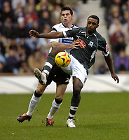 Photo: Leigh Quinnell.<br /> Derby County v Plymouth Argyle. Coca Cola Championship. 30/12/2006. Plymouths Sylvan Ebanks Blake battles with Derbys Marc Edworthy.