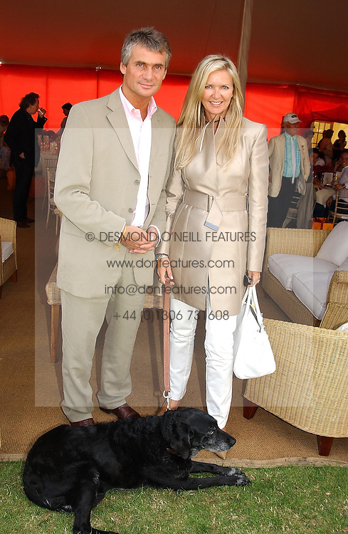 Fashion designer AMANDA WAKELEY and MR CHRISTOPHER  WHALLEY at the Veuve Clicquot sponsored Gold Cup or the British Open Polo Championship won by The  Azzura polo team who beat The Dubai polo team 17-9 at Cowdray Park, West Sussex on 18th July 2004.