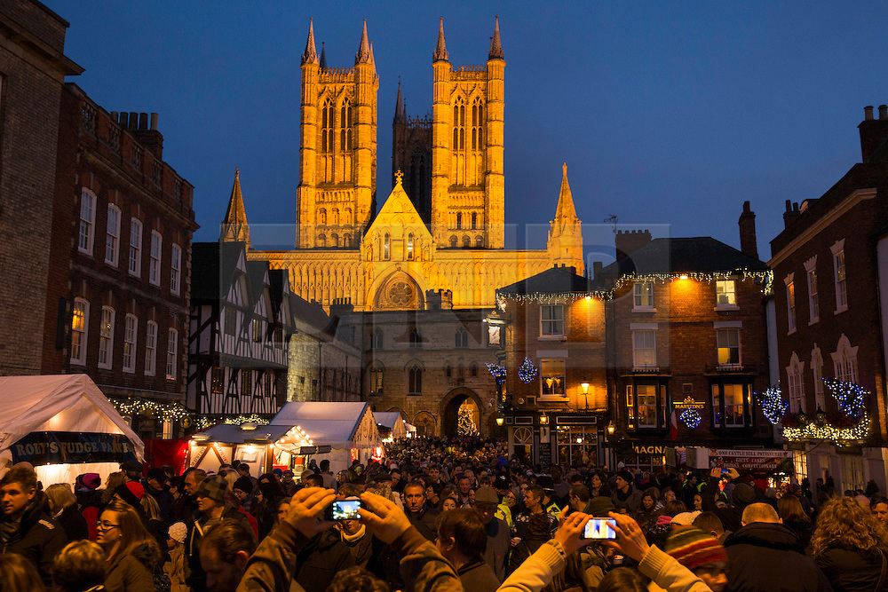 "© Licensed to London News Pictures. 7/12/2013. Lincoln, UK. Lincoln City Centre was packed with Christmas shoppers this weekend. Thousands of shoppers filled the City Centre and stewards were called in to direct people up the narrow ""Steep Hill"" towards the upper area of Lincoln near the Cathedral. Photo credit : Dave Warren/LNP"
