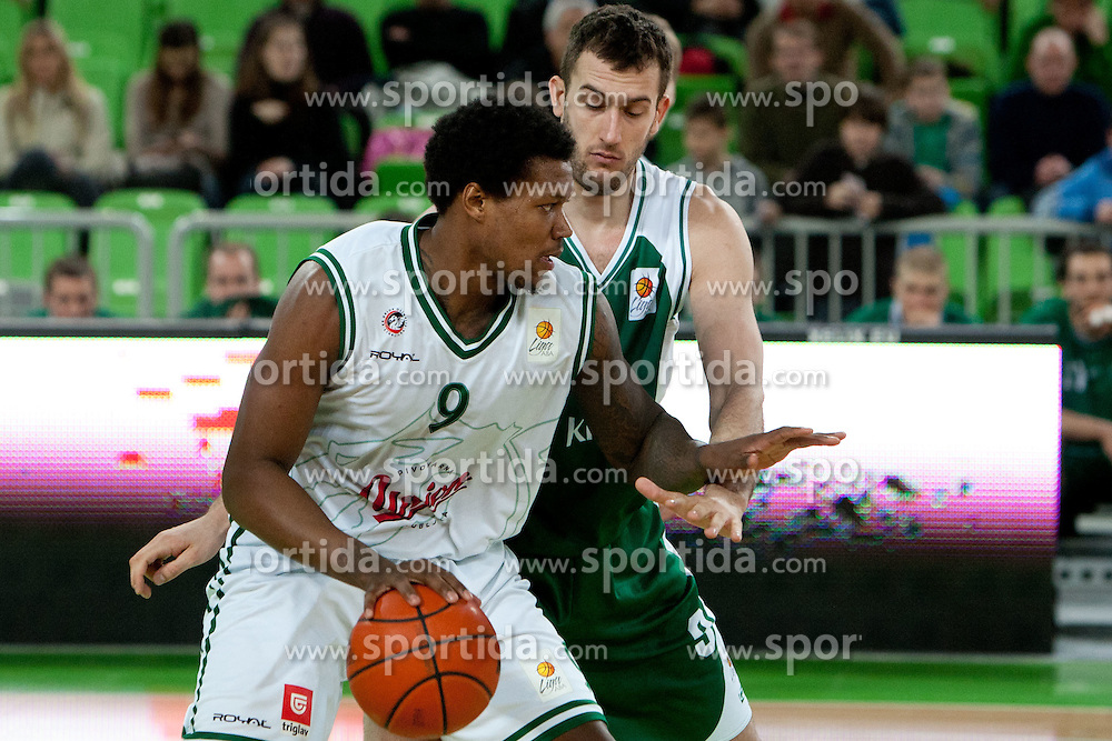 Deon Thompson of KK Union Olimpija vs Smiljan Pavic of KRKA Novo Mesto during basketball match between KK Union  Olimpija and and KK KRKA Novo Mesto in 20th Round of ABA League, on February 11, 2012, in Arena Stozice, Slovenia. (Photo by Matic Klansek Velej / Sportida)