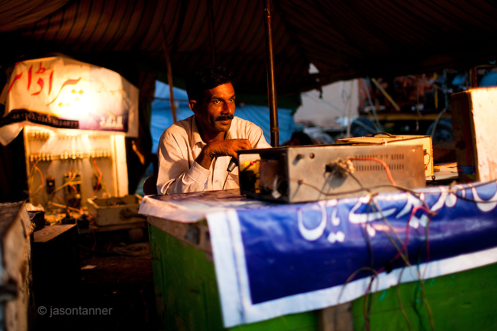 Islamabad: A public announcer  with the Jan Baz Circus preparing for an evenings entertainment at Pothohari Village in Islamabad...©jtanner 2010