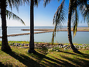 01 JULY 2015 - NONG BUA, LOPBURI, THAILAND:  The recreational area at Pa Sak Dam, an agricultural reservoir. All of the land behind the trees is normally submerged. Central Thailand is contending with drought. By one estimate, about 80 percent of Thailand's agricultural land is in drought like conditions and farmers have been told to stop planting new acreage of rice, the area's principal cash crop. Water in reservoirs are below 10 percent of their capacity, a record low. Water in some reservoirs is so low, water no longer flows through the slipways and instead has to be pumped out of the reservoir into irrigation canals. Farmers who have planted their rice crops are pumping water out of the irrigation canals in effort to save their crops. Homes have collapsed in some communities on the Chao Phraya River, the main water source for central Thailand, because water levels are so low the now exposed embankment is collapsing. This is normally the start of the rainy season, but so far there hasn't been any significant rain.    PHOTO BY JACK KURTZ
