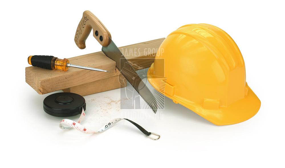 hard hat, saw, 2x4, screwdriver on white