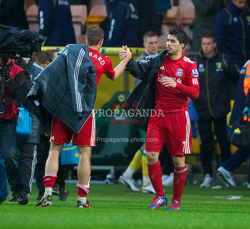 NORWICH, ENGLAND - Saturday, April 28, 2012: Job done Liverpool's Luis Alberto Suarez Diaz and captain Steven Gerrard after the 3-0 victory over Norwich City during the Premiership match at Carrow Road. (Pic by David Rawcliffe/Propaganda)
