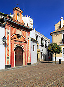 Attractive historic doorway and buildings in old inner city, Cordoba, Spain