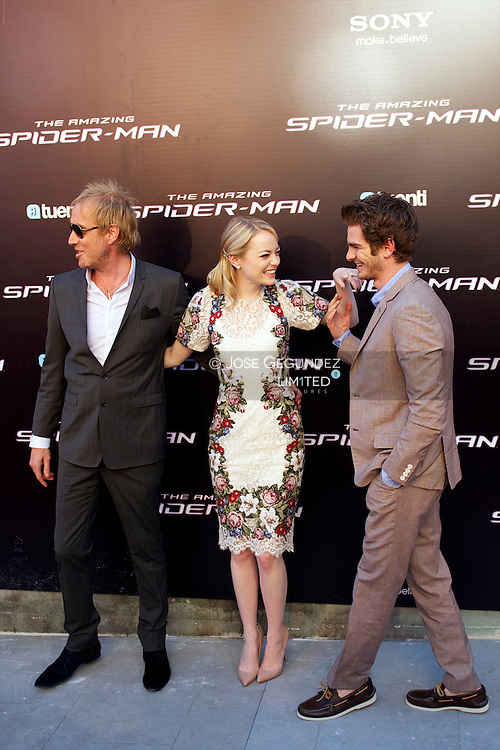 Actor Rhys Ifans, actress Emma Stone and actor Andrew Garfield attend the premiere of 'The Amazing Spider-Man' at Callao Cinema in Madrid