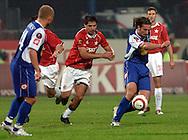 n/z.: Radoslaw Sobolewski (nr7-Wisla), Tomasz Iwan (nr8-Lech) podczas meczu ligowego Wisla Krakow (czerwone-biale) - Lech Poznan (niebieskie) 5:1 , I liga polska , 8 kolejka sezon 2005/2006 , pilka nozna , Polska , Warszawa , 24-09-2005 , fot.: Adam Nurkiewicz / mediasport..Radoslaw Sobolewski (nr7-Wisla), Tomasz Iwan (nr8-Lech) fight for the ball during Polish league first division soccer match in Cracow. September 24, 2005 ; Wisla Cracow (red-white) - Lech Poznan (blue) 5:1 ; 8 round season 2005/2006 , football , Poland , Cracow ( Photo by Adam Nurkiewicz / mediasport )