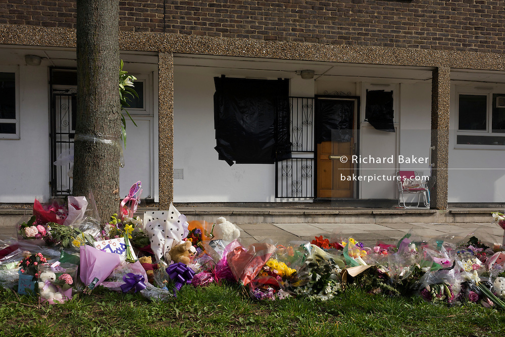 Floral tributes to murdered actress Gemma McCluskie outside the former Eastender's Hackney home.