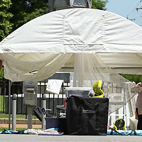 "Bobby Farley and his wife Debra, from Pelham Alabama, set up their tent where they will showcase their jewelry ""The Charming Cherub"" Friday afternoon in Tupelo. This year marks the 47th Annual Gumtree Festival in downtown Tupelo."