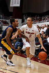 December 15, 2010; Stanford, CA, USA;  Stanford Cardinal guard Aaron Bright (2) is defended by North Carolina A&T Aggies guard Jeremy Underwood (3) during the first half at Maples Pavilion.