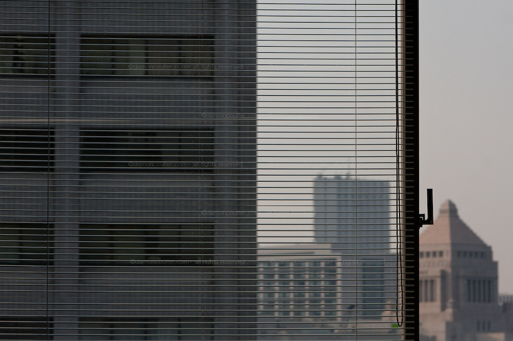 The distiinctive Japanese Diet building seen through a window  of the Ministry of Economy, Trade and Industry (METI) in Tokyo Japan. Friday November 4th 2011