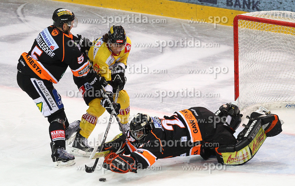 25.01.2013, Albert Schultz Eishalle, Wien, AUT, EBEL, UPC Vienna Capitals vs Graz 99ers, 2. Zwischenrunde, im Bild Dustin Van Ballegooie, (Graz 99ers, #5), Tony Romano, (UPC Vienna Capitals, #8) und Sebastian Stefaniszin, (Moser Medical Graz 99ers, #27) // during the Erste Bank Icehockey League 2nd placement Round match betweeen UPC Vienna Capitals and Graz 99ers at the Albert Schultz Ice Arena, Vienna, Austria on 2013/01/25. EXPA Pictures © 2013, PhotoCredit: EXPA/ Thomas Haumer