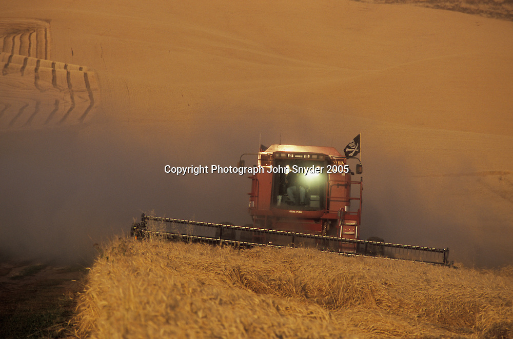Wheat harvest in the Palouse hills of Eastern Washington and Northern Idaho. A combine negotiates the hilly terrain of the Palouse, one of the most productive dry-farming regions in the world