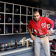 NEW YORK, NEW YORK - July 10: Danny Espinosa #8 of the Washington Nationals in the dugout preparing to bat during the Washington Nationals Vs New York Mets regular season MLB game at Citi Field on July 10, 2016 in New York City. (Photo by Tim Clayton/Corbis via Getty Images)