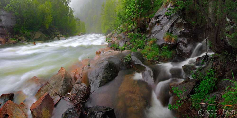 A panoramic view of the roaring power of the Chiusella river after a long period of pouring rain, and with the addition of snow meltdown from higher altitudes. Taken at the end of May in Valchiusella, Piedmont, Italy, this is a stitch of 6 vertical takes.