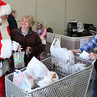 Santa Claus visits with Donna Murphree and Dr. Len Pinkley last week during distribution day at the Amory Food Pantry.