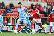 Bolton Wanderers Forward, Gary Madine (14) and Swindon Town Defender, Nathan Thompson (2) during the EFL Sky Bet League 1 match between Swindon Town and Bolton Wanderers at the County Ground, Swindon, England on 8 October 2016. Photo by Adam Rivers.