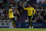 Rilee Rossouw and Mujeeb Ur Rahman of Hampshire celebrate the wicket of Eoin Morgan during the Vitality T20 Blast South Group match between Hampshire County Cricket Club and Middlesex County Cricket Club at the Ageas Bowl, Southampton, United Kingdom on 20 July 2018. Picture by Dave Vokes.