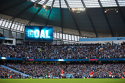 MANCHESTER, ENGLAND - Sunday, November 2, 2014: Manchester City supporters celebrate their side's goal against Manchester United during the Premier League match at the City of Manchester Stadium. (Pic by David Rawcliffe/Propaganda)