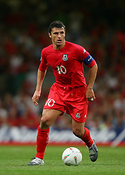 CARDIFF, WALES - Wednesday, September 8, 2004: Wales' captain Gary Speed in action against Northern Ireland during the Group Six World Cup Qualifier at the Millennium Stadium. (Pic by David Rawcliffe/Propaganda)