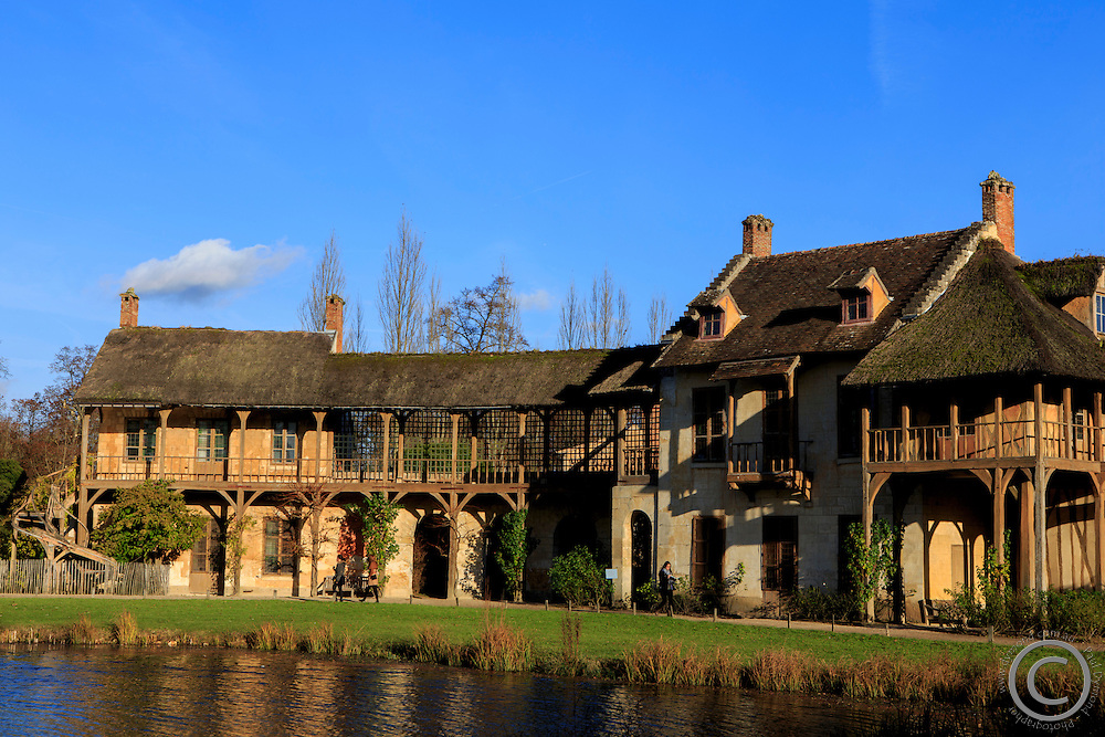 The hameau de la reine is a model village built on the orders of Marie Antoinette within the grounds of the Petit Trianon, her private sanctuary within the gardens of the Palace of Versaille, Paris, France