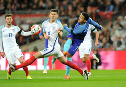 Memphis Depay of the Netherlands shoots under pressure from John Stones of England  - Mandatory by-line: Dougie Allward/JMP - 29/03/2016 - FOOTBALL - Wembley Stadium - London, United Kingdom - England v Netherlands - International Friendly