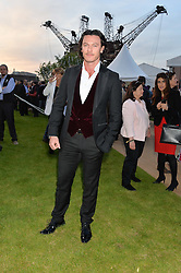 LUKE EVANS at the Battersea Power Station Annual Party at Battersea Power Station, 188 Kirtling Street, London SW8 on 30th April 2014.