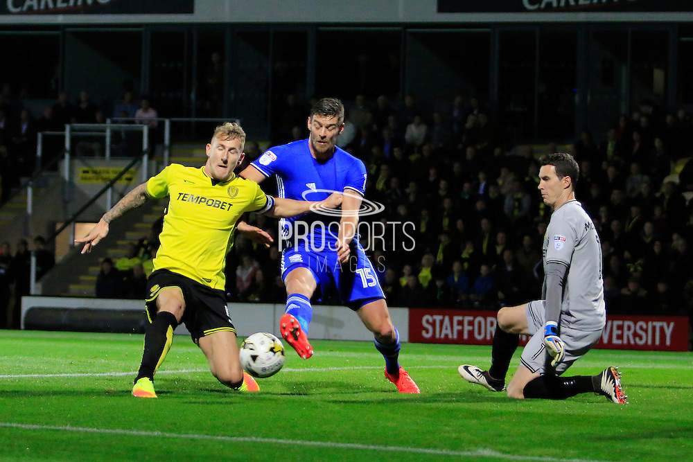 Birmingham's Lukas Jutkiewicz (15) has a shot during the EFL Sky Bet Championship match between Burton Albion and Birmingham City at the Pirelli Stadium, Burton upon Trent, England on 21 October 2016. Photo by Richard Holmes.