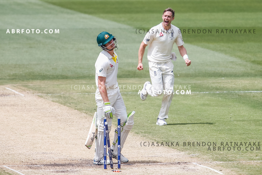 Chris Woakes celebrates after bowling a disappointed Cameron Bancroft who walks off after being bowled during day 4 of the 2017 boxing day test.