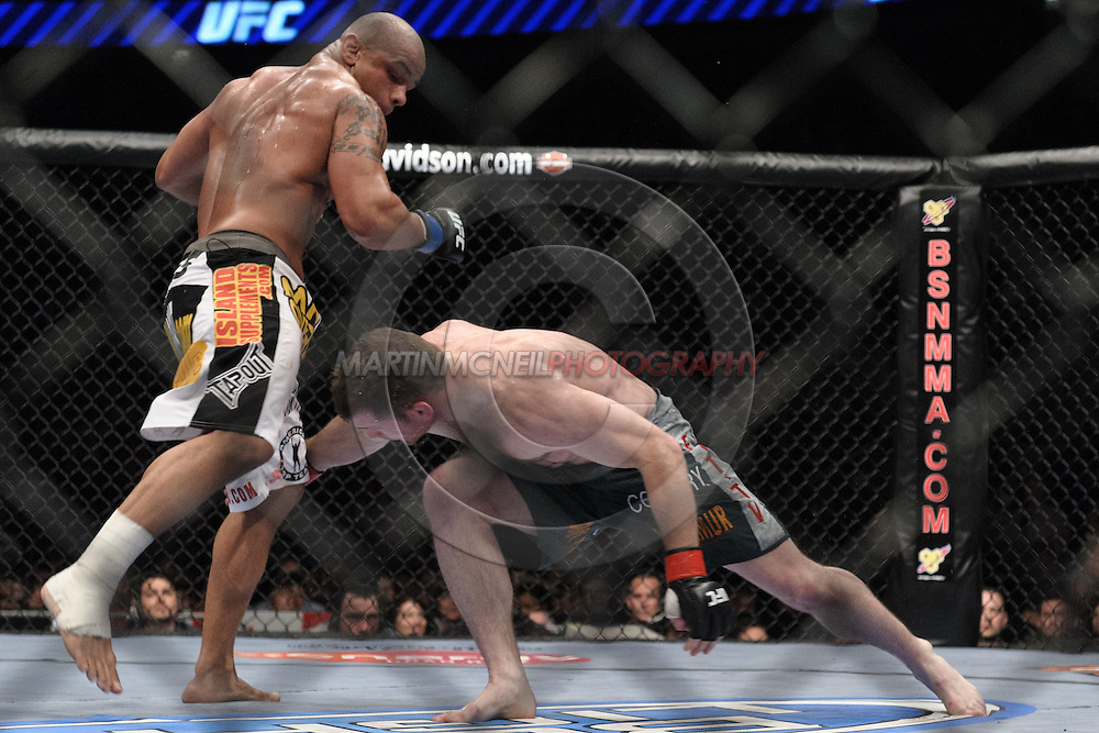 "LONDON, ENGLAND, JUNE 7, 2008: Thiaog Alves (left) evades a takedown attempt by Matt Hughes during ""UFC 85: Bedlam"" inside the O2 Arena in Greenwich, London on June 7, 2008."