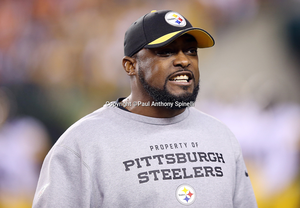 Pittsburgh Steelers head coach Mike Tomlin calls out during pregame warmups before the NFL AFC Wild Card playoff football game against the Cincinnati Bengals on Saturday, Jan. 9, 2016 in Cincinnati. The Steelers won the game 18-16. (©Paul Anthony Spinelli)