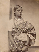 Woman in sari with elaborate necklace.