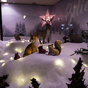 Children and adults enjoy the sights during Christmasville in Old Town.
