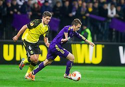 Daniel Carrico of Sevilla vs Dejan Mezga of Maribor during football match between NK Maribor and Sevilla FC (ESP) in 1st Leg of Round of 32 of UEFA Europa League 2014 on February 20, 2014 at Stadium Ljudski vrt, Maribor, Slovenia. Photo by Vid Ponikvar / Sportida