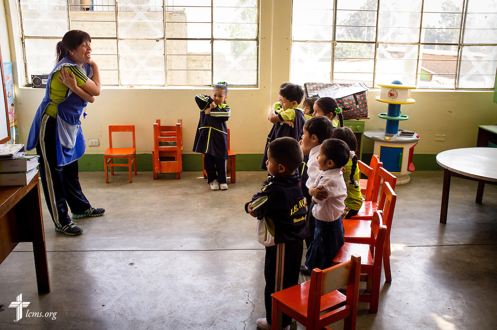 A teacher leads school children in song at the Noe school (Spanish for Noah) near Lima, Peru, on Tuesday, April 7, 2015. The school was affected by landslides after heavy rains unleashed avalanches of mud and rocks around the region. LCMS Communications/Erik M. Lunsford