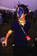 Boy with blue face paint and a creamfields pass around his neck Creamfields 2000