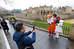 © Licensed to London News Pictures. 06/02/2019. London, UK.  An actor dressed as a Beefeater for the GMB Union poses with a tourist for a photograph during a protest outside the Tower of London this afternoon. GMB union members working for Historic Royal Palaces (HRP) are striking today at the Tower of London over the closure of their pension scheme. Photo credit: Vickie Flores/LNP