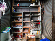 04 JANUARY 2016 - BANGKOK, THAILAND:        An abandoned shop in Bang Chak Market. The market closed January 4, 2016. The Bang Chak Market serves the community around Sois 91-97 on Sukhumvit Road in the Bangkok suburbs. About half of the market has been torn down. Bangkok city authorities put up notices in late November that the market would be closed by January 1, 2016 and redevelopment would start shortly after that. Market vendors said condominiums are being built on the land.     PHOTO BY JACK KURTZ